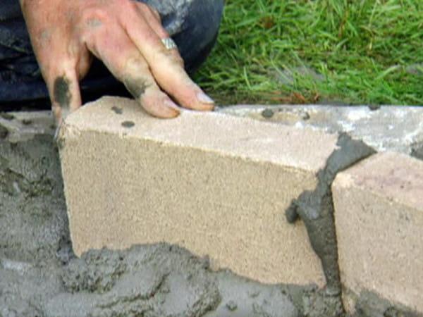 Adding mortar before fire bricks